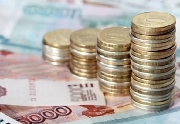 Официальный рубль укрепился к доллару и евро