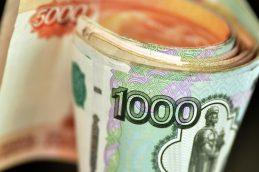 Рубль ослаб к доллару по итогам основной валютной сессии